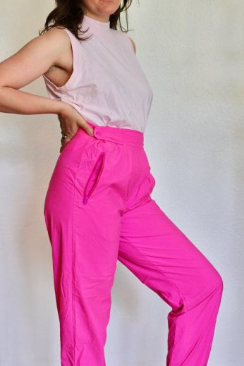 Image of bright pink track pants.
