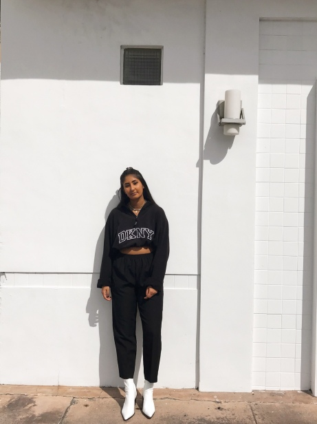 Image of a woman posing in front of a white wall.